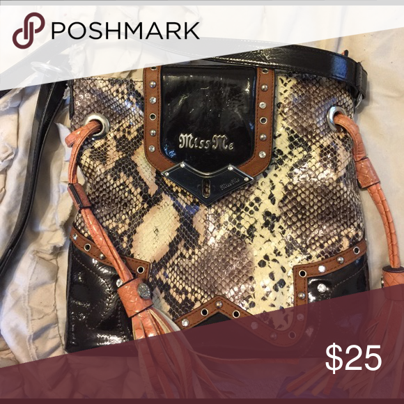 Miss Me crossbody purse Western style, brown and black faux snake skin with pink tassels. Miss Me Bags Crossbody Bags