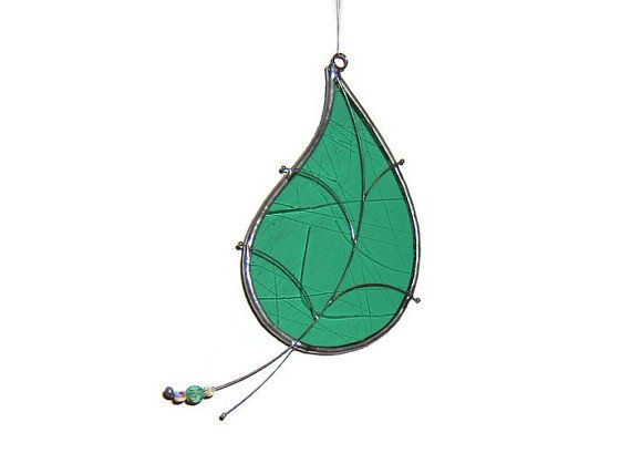 Falling green leaf suncatcher. Pale green textured glass with beads ...