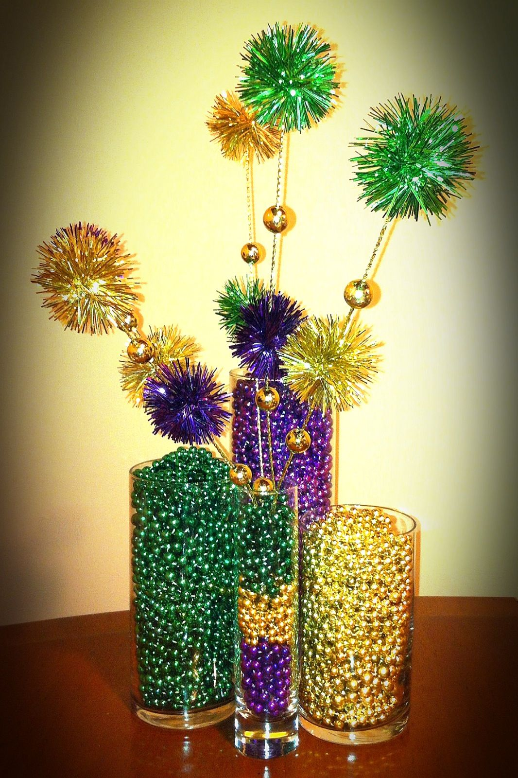 DIY Mardi Gras Bead Craft, it would look nice on the sign in table ...