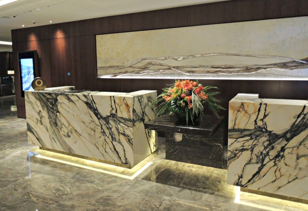 The beautiful marble check in desks on the 35th floor at the Shangri-La London Hotel located inside The Shard