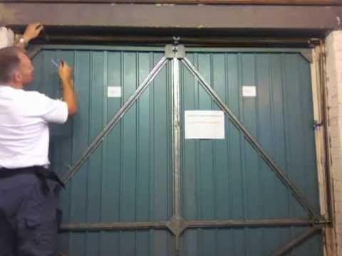 Henderson Merlin Garage Door How To Add Tension To The Main Spring Mov Garage Door Cable Garage Doors Garage Door Spring Replacement