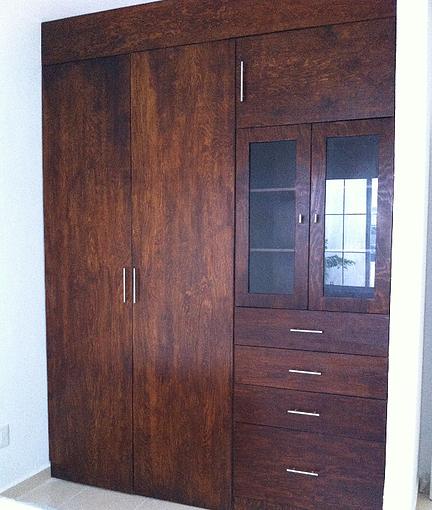 Closet made with 15mm pine plywood, Walnut stain, acrylic varnish finish.