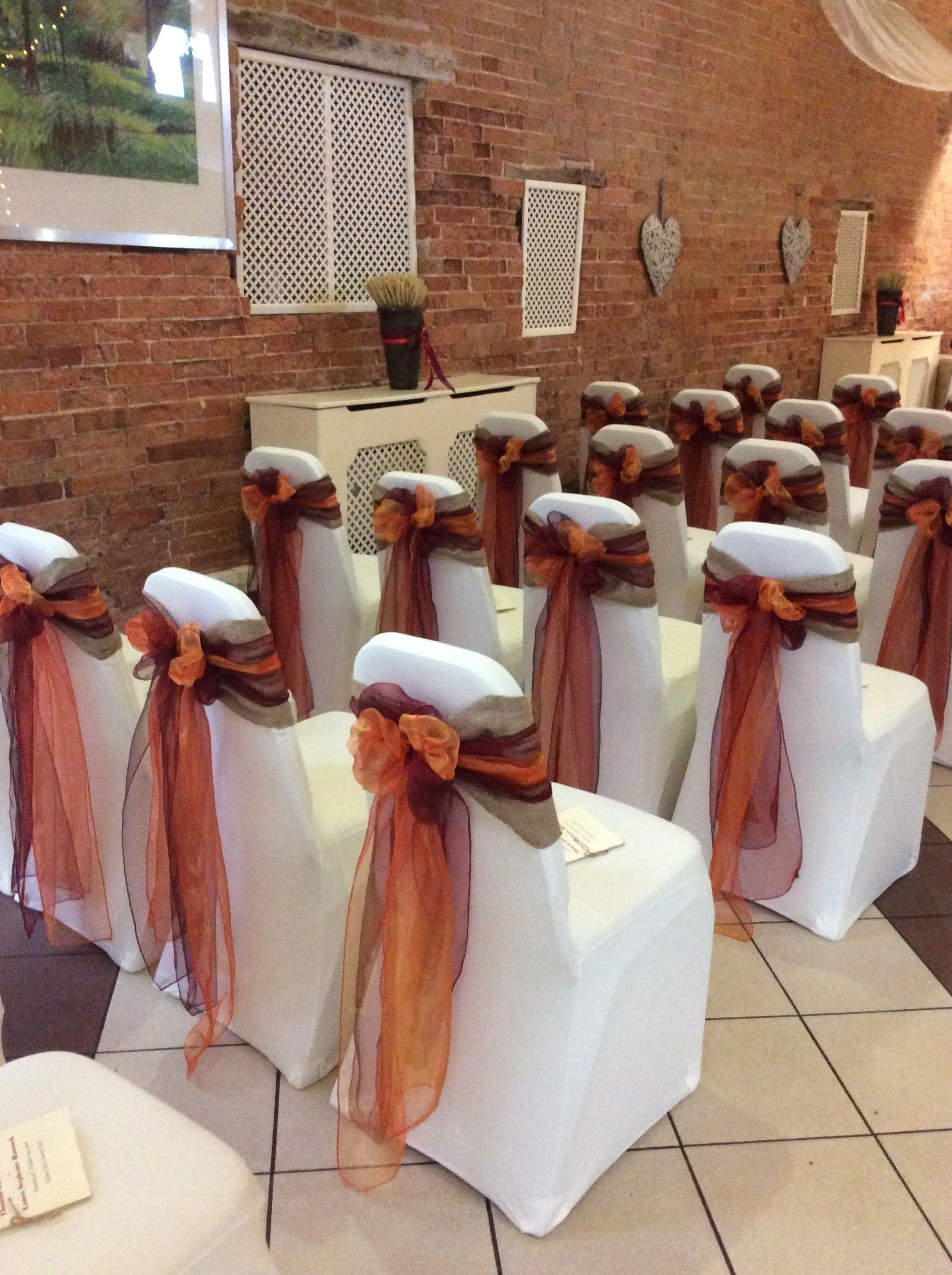 burgundy chair covers wedding adirondack chairs plans hessian topped with and orange sashes for an autumnal theme www beautifulvenuedecor co uk