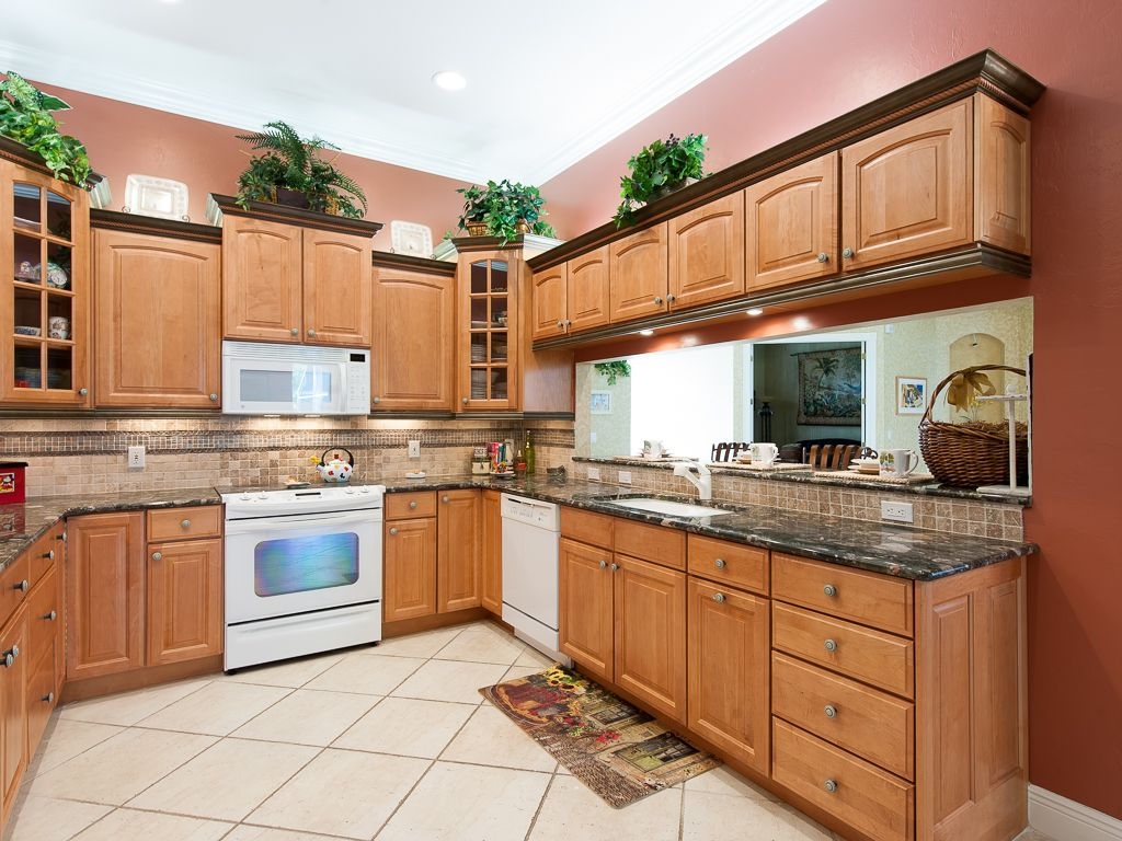Stunning gourmet kitchen with granite counters & tile