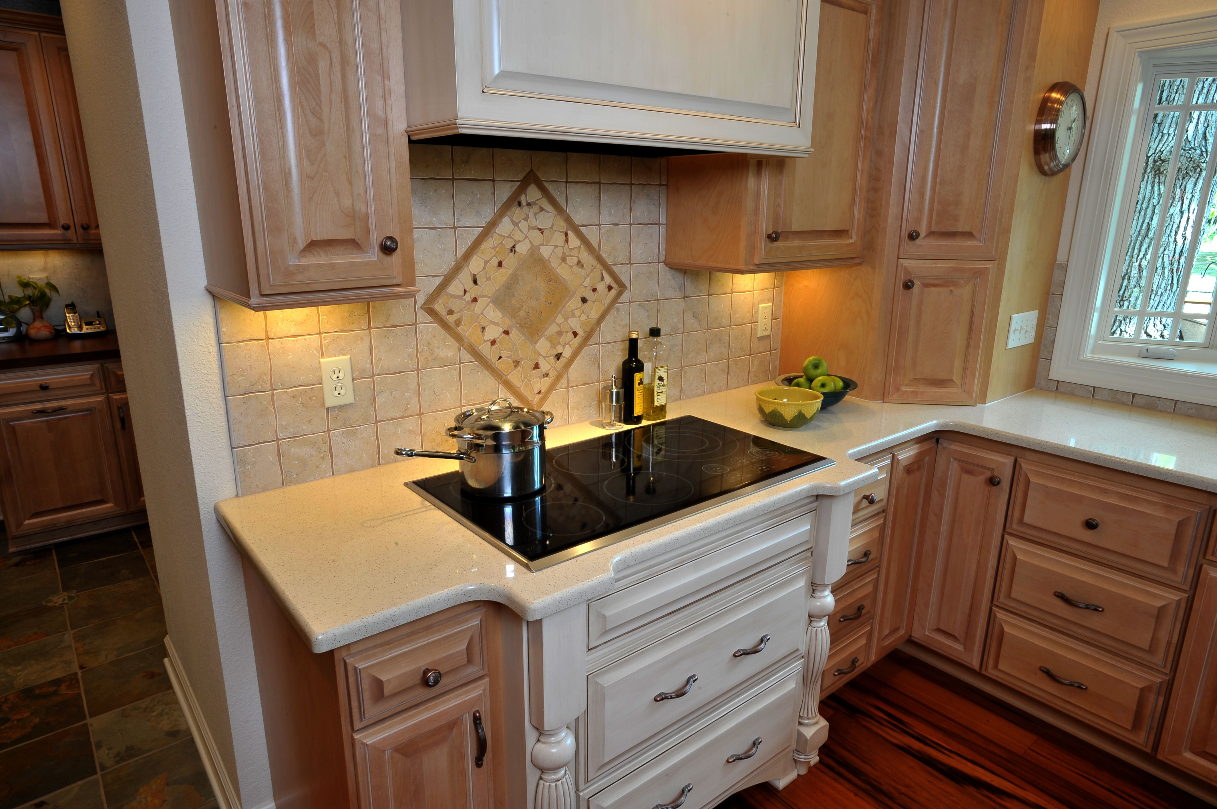 The redesigned kitchen has ceiling-high custom birch ...