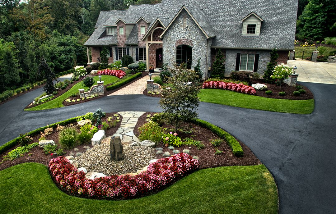 Large estate landscape design and build long tree lined driveway leading to a circular driveway Home driveway design ideas