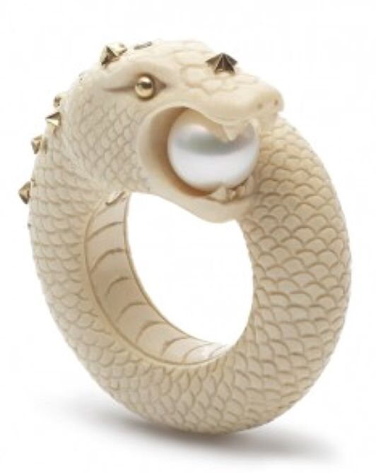 The Sea Snake ring is made out of40k years old mammoth tusk and inlaid with 18ct gold, tsavorite and pearl.    AsCollection, this ring is made of 40,000 year old woolly mammoth tusk discovered under the permafrost in Siberia. Carved to perfection and inlaid with 18ct gold and precious stones, each piece of the collection is an artwork in itself. The captivating designs are based upon prehistoric animals just like the material they are made of.