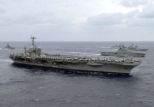 """U.S. Navy's forward-deployed aircraft carrier USS George Washington (CVN 73) was awarded the Commander, Naval Air Forces Carrier Battle Effectiveness Award, or Battle """"E"""", Feb. 15.Battle """"E"""" recognizes sustained superior performance in an operational environment, and sustained continuous readiness throughout the Forward Deployed Naval Forces training plan."""