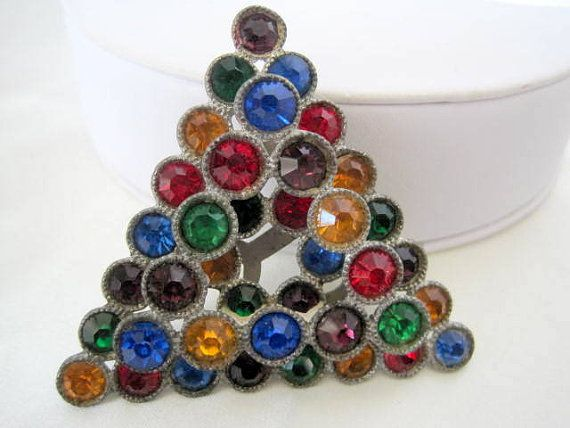 Gorgeous Art Deco  multicolor rhinestone dress clip presented by VintagObsessions. This dress clip i
