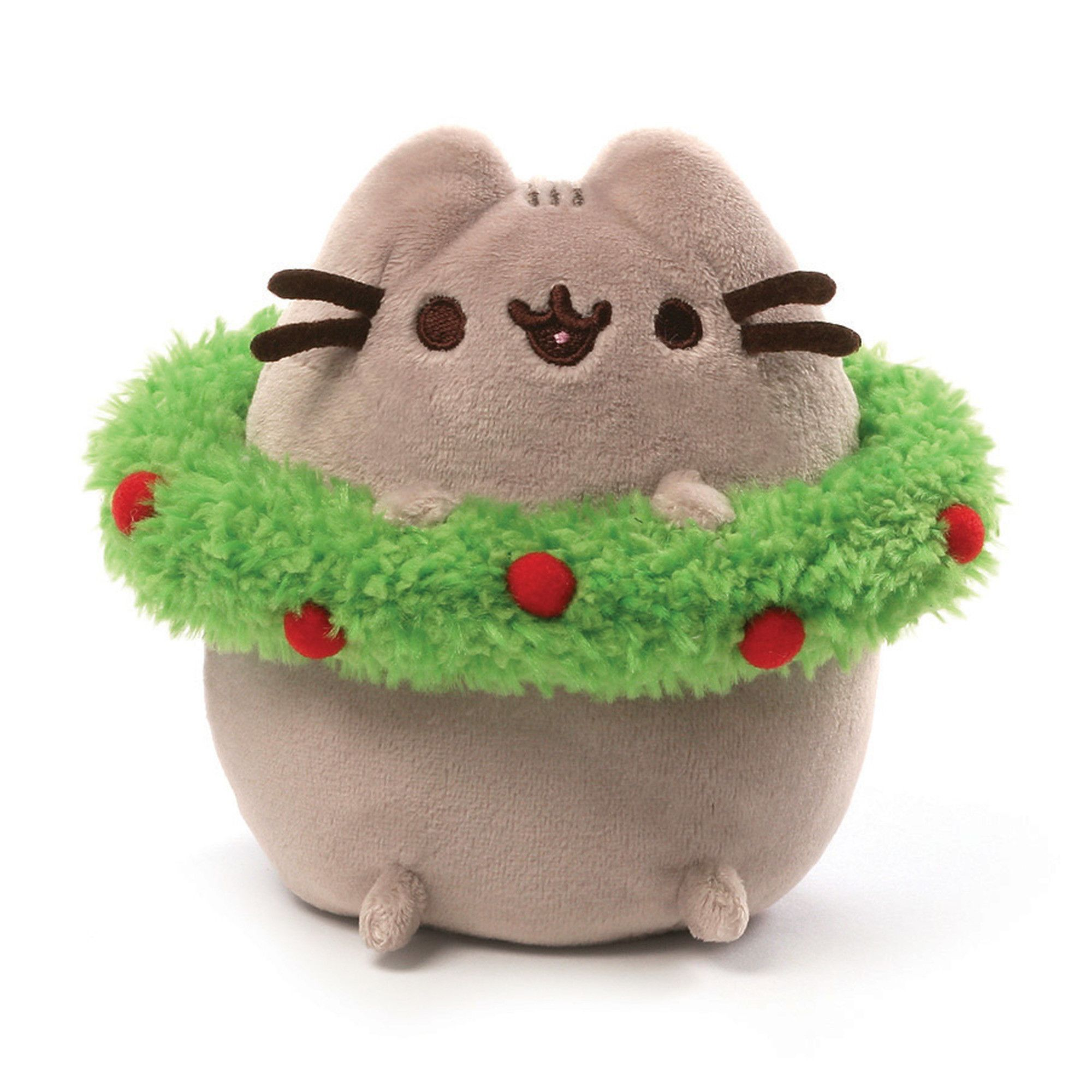 """This 4.5"""" Pusheen holiday plush is ready to celebrate the season with a festive red and green wreath. - Pusheen plush toy in classic pose brings adorable web comic to life - Features cute holiday-them"""