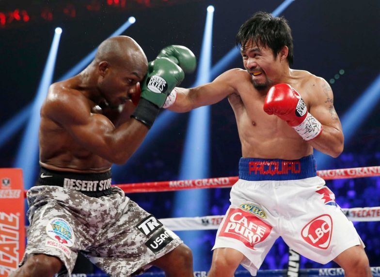 Manny Pacquiao, right, of the Philippines, throws a right