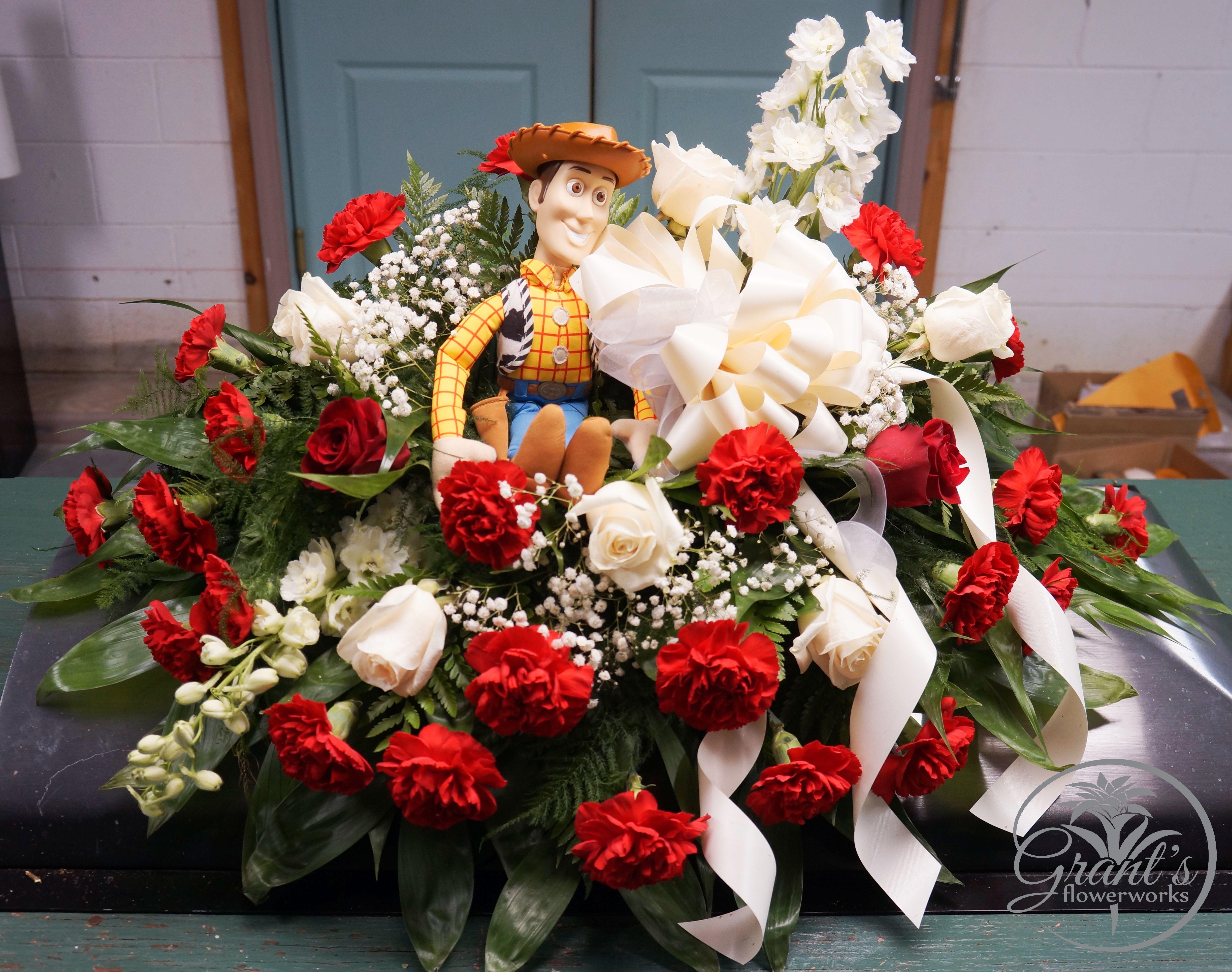 Childs casket spray by grants flowerworks casket