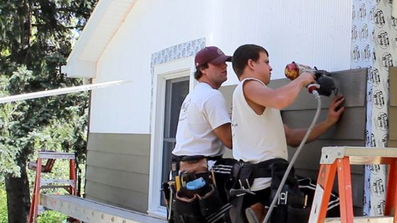 Craftsmen nail siding to the InSoFast insulation panel studs