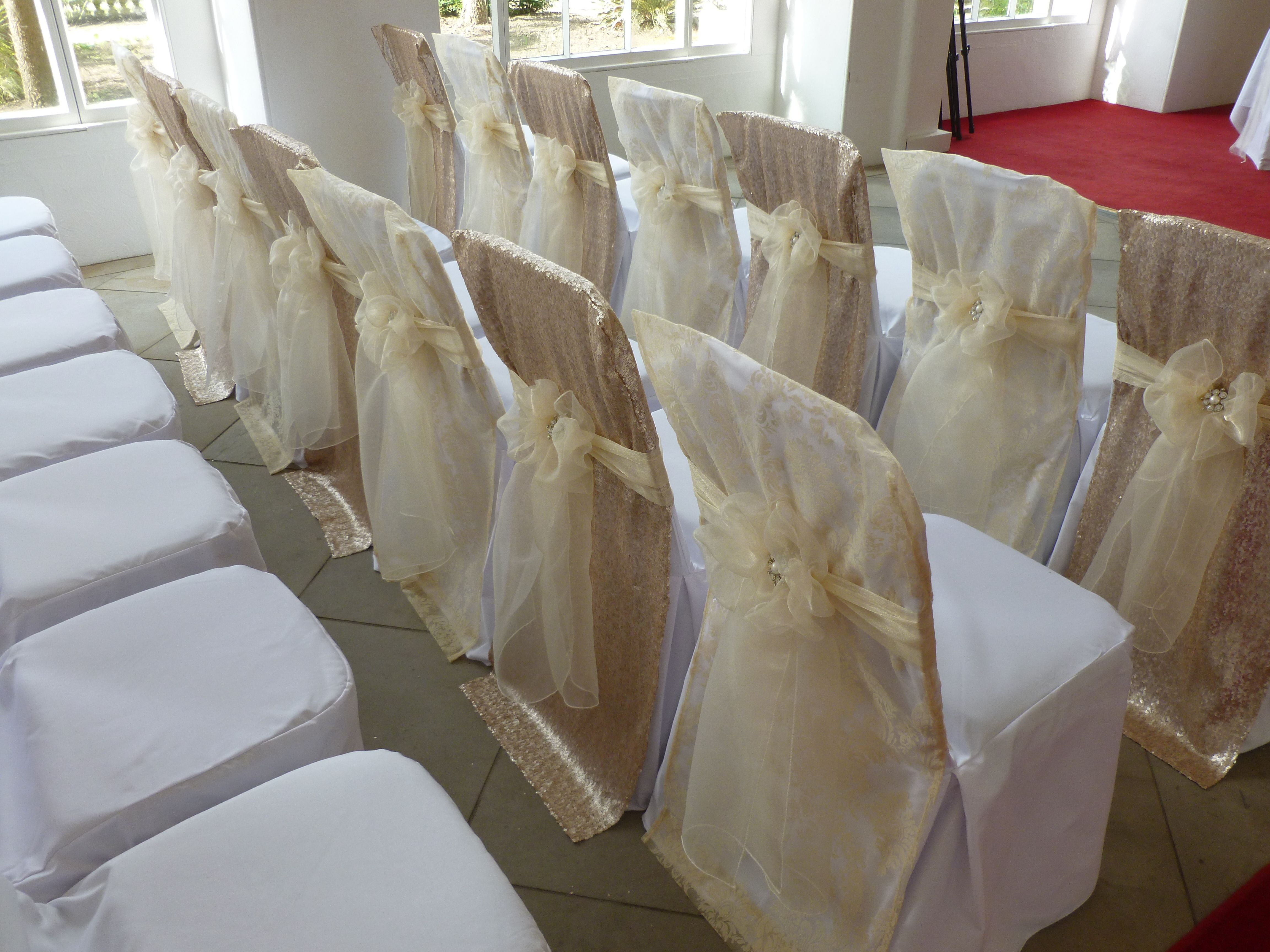wedding chair covers and bows south wales twin sofa sleeper sequin chairs flock with champagne organza sash