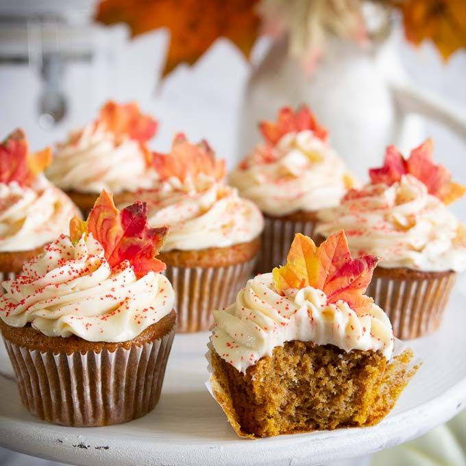 Pumpkin cupcakes with cream cheese frosting and candy leaf topper by simplyhomecooked.com #pumpkincupcakes #pumpkinrecipes #autumn #fallbaking #wiltoncakes #candymelts #cupcakerecipes #baking #pumpkinspicecupcakes