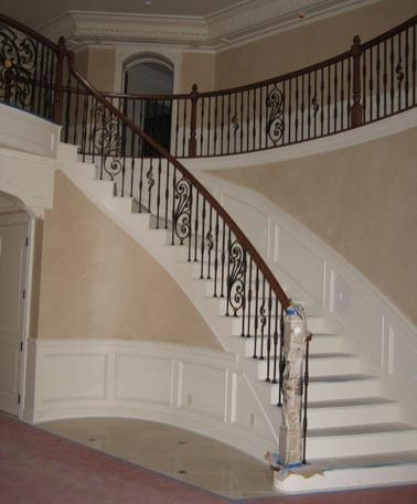 Three story foyer double curved staircases with ornate for Double curved staircase