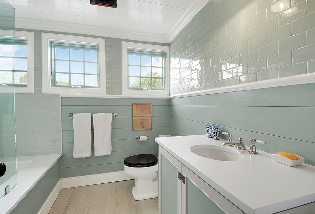 Unique Bathroom With Ship Lap Siding And Subway Tiles