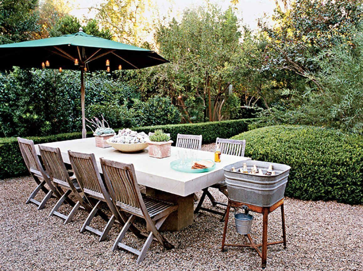 luxury backyard patio made from decorative pea gravel stone with