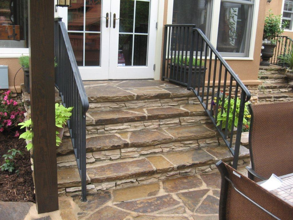 Flagstone steps and black iron rail leading down from for Outdoor steps ideas