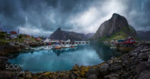 Hamnøy by OleHenrikSkjelstad  sea mountains water ocean rocks boats village gray rorbu fishing boats Hamnøy Norge Norway Lofoten H