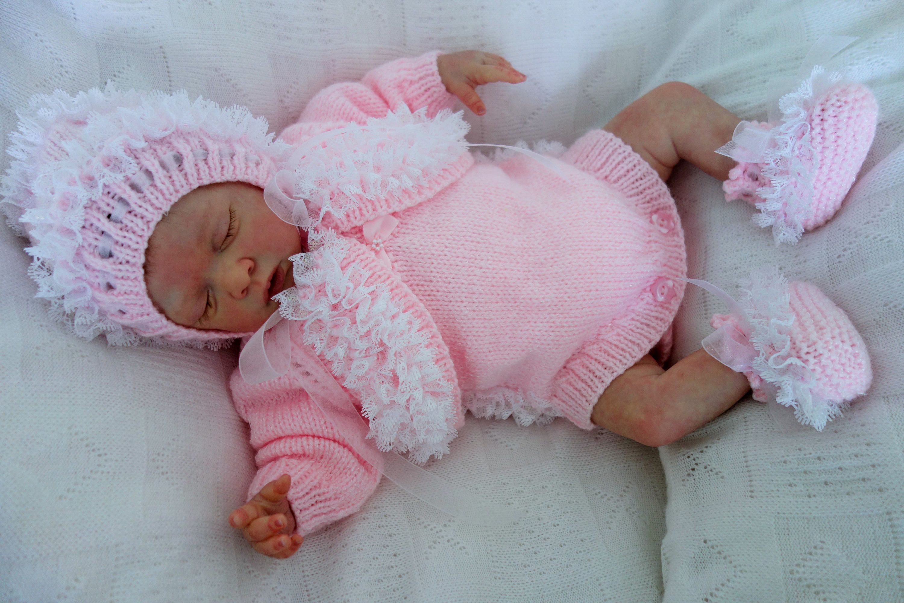 Hand knitted newborn baby girl s fancy lace trimmed pink outfit.  Bolero shrug bd33e038ba8