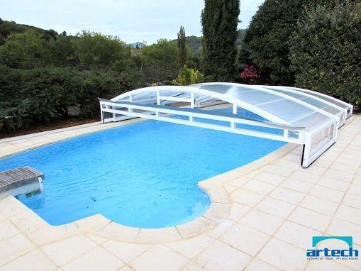 Abri de piscine bas télescopique sur piscine Desjoyaux ovoïde