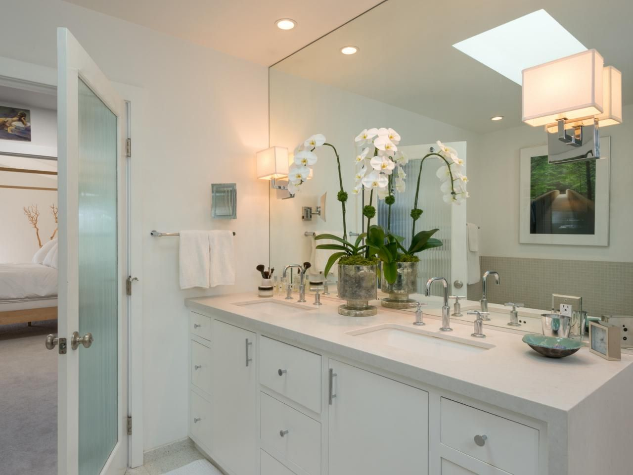 A White Caesarstone Countertop Wraps Down One Side Of This