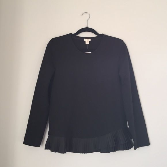 Jcrew long sleeve This top is brand new from jcrew outlet! It's a fun black top but with the surprise ruffle along the edges!!! J. Crew Tops Tees - Long Sleeve