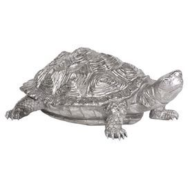 "This distinctive turtle decor proves silver and shiny wins the race. The lifelike details give it a realistic feel, but its pewter finish makes it cooler than anything you'll find pondside.   Product: StatuetteConstruction Material: ResinColor: SilverDimensions: 6"" H x 16"" W x 9"" D"