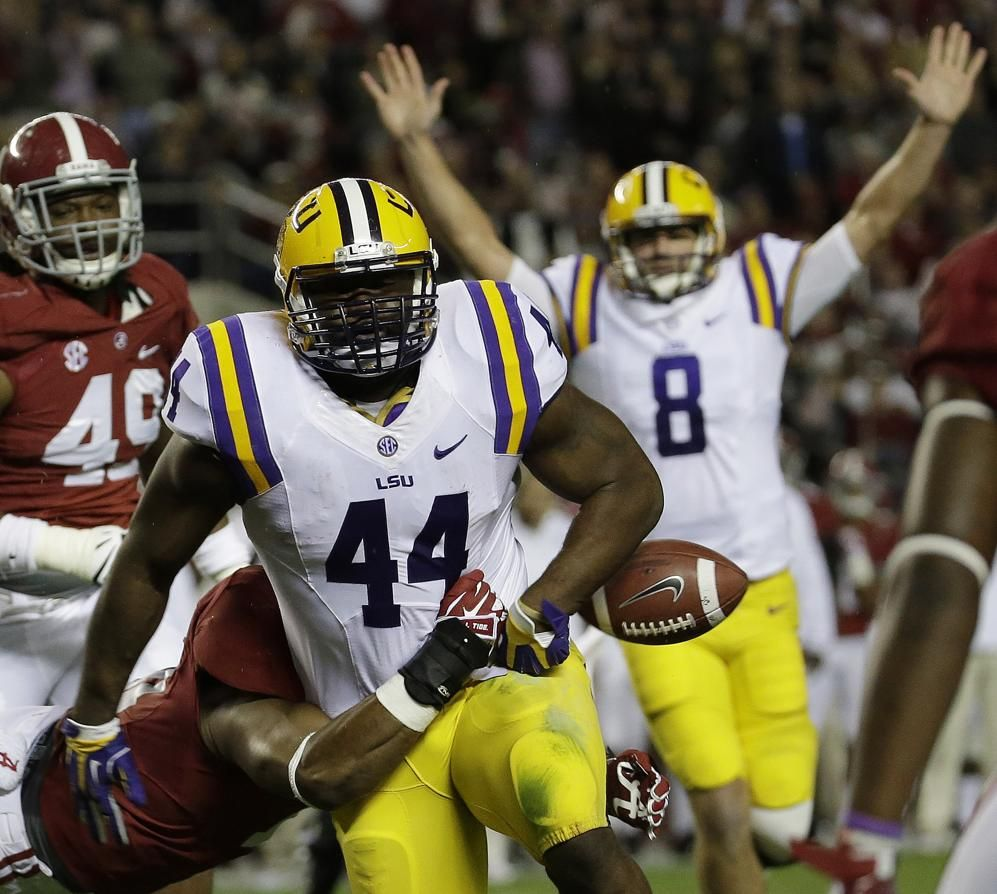 LSU fullback J.C. Copeland (44) has the ball stripped from