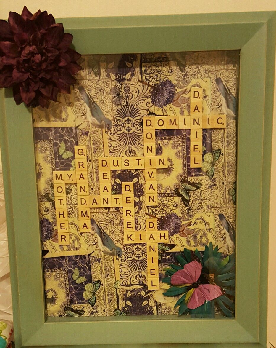 Mothers Day present we made with her children's and grandchildrens names  using scrabble tiles and a shadow box frame.