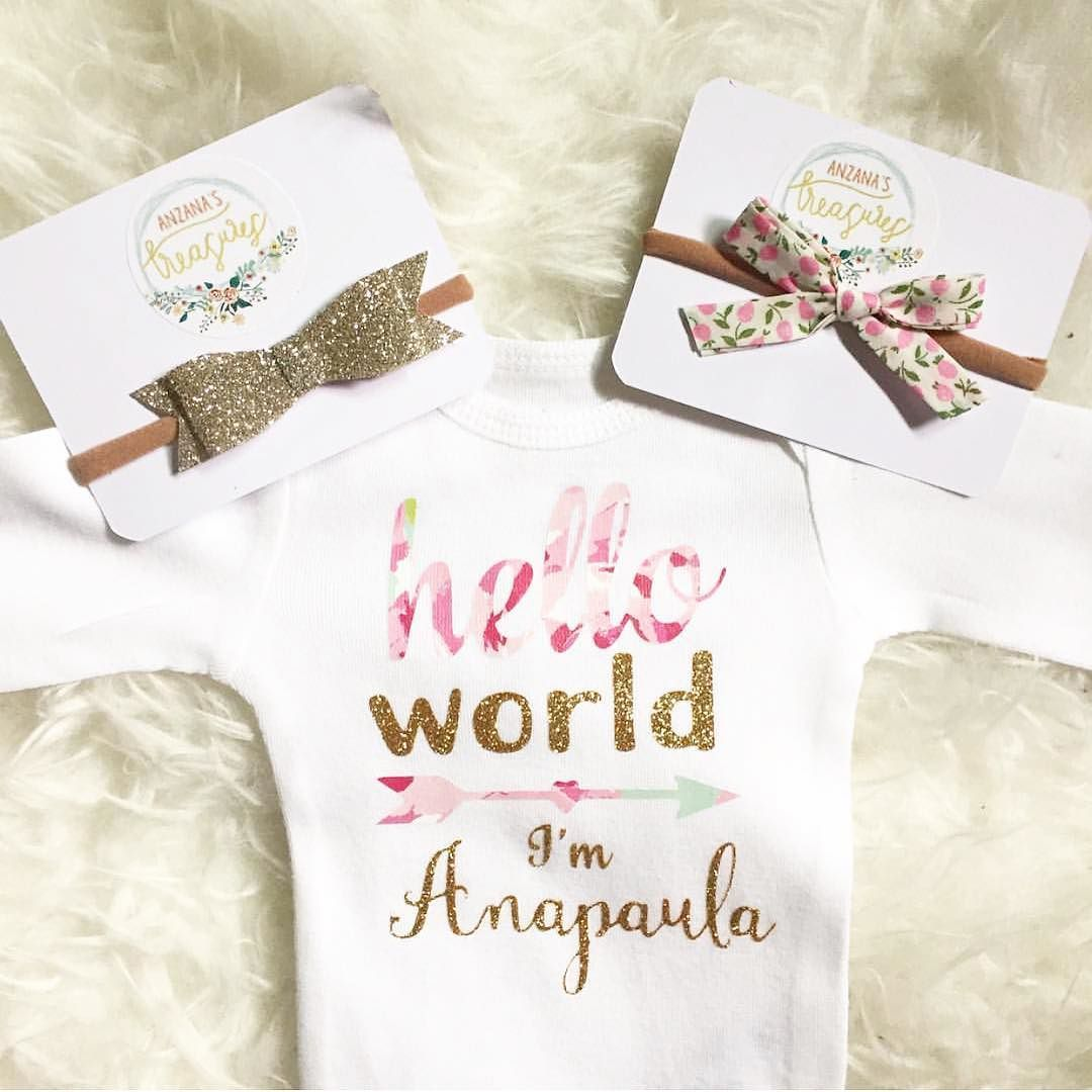 "I am obsessed with this First Onesie from my friend @felixandfrazzled  it's so perfect for announcing your pregnancy or sharing your babes name or her ""coming home"" outfit. You also get to choose one of these #anzanastreasures headbands to accessorize her with  go to @felixandfrazzled to order!"