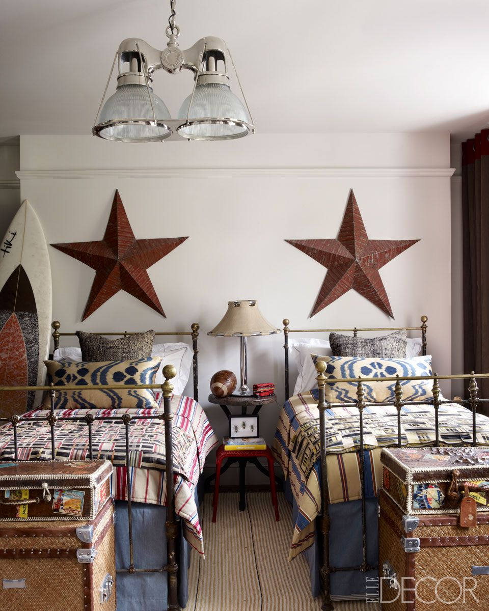 Country Boy's Bedroom...with rustic stars, iron beds, and quilted bedding.