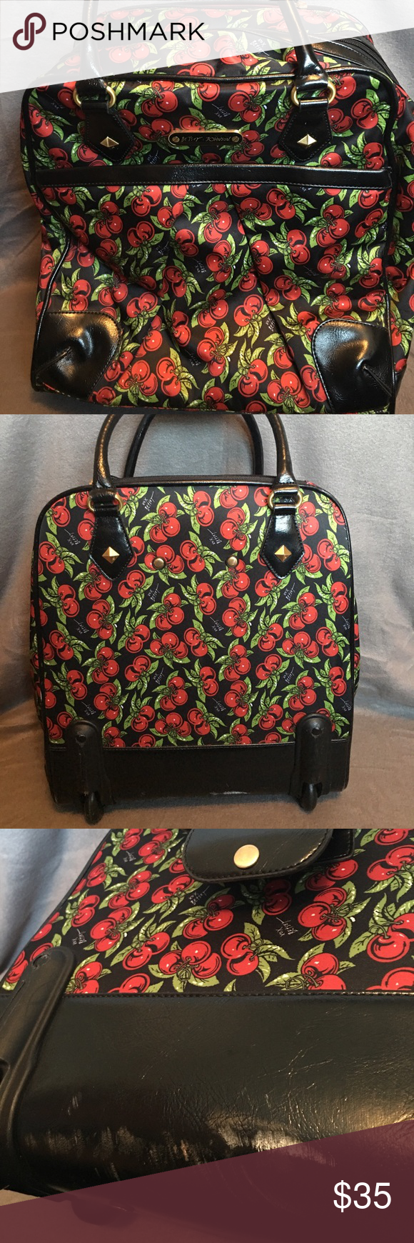 BETSEY JOHNSON ROLLER Great small rolling bag. Looks brand new except for the scuffs on the back side Betsey Johnson Bags Travel Bags