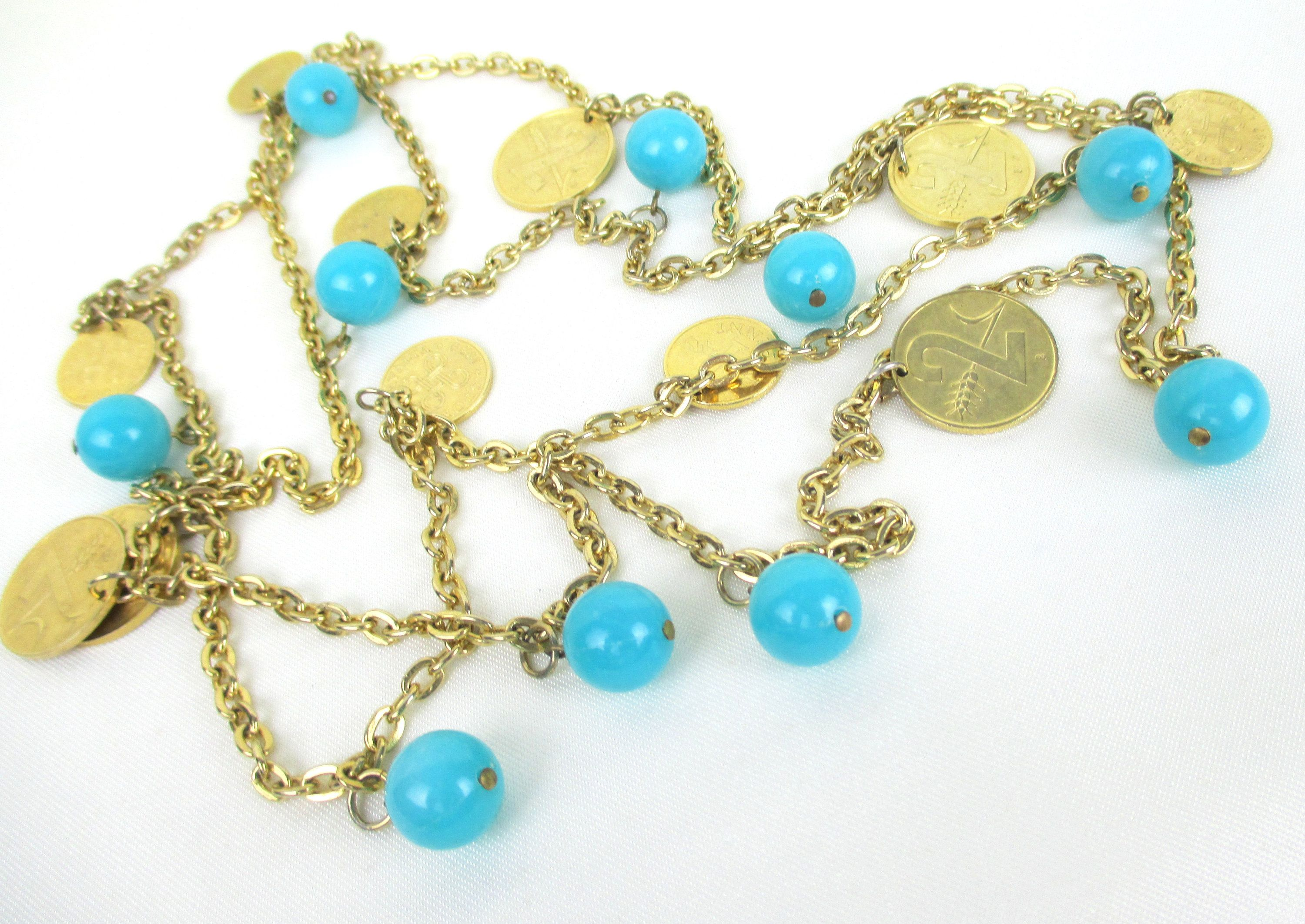 Center beads are butterflies Bracelet beaded on gold wire with translucent yellow beads Goldtone accent beads.