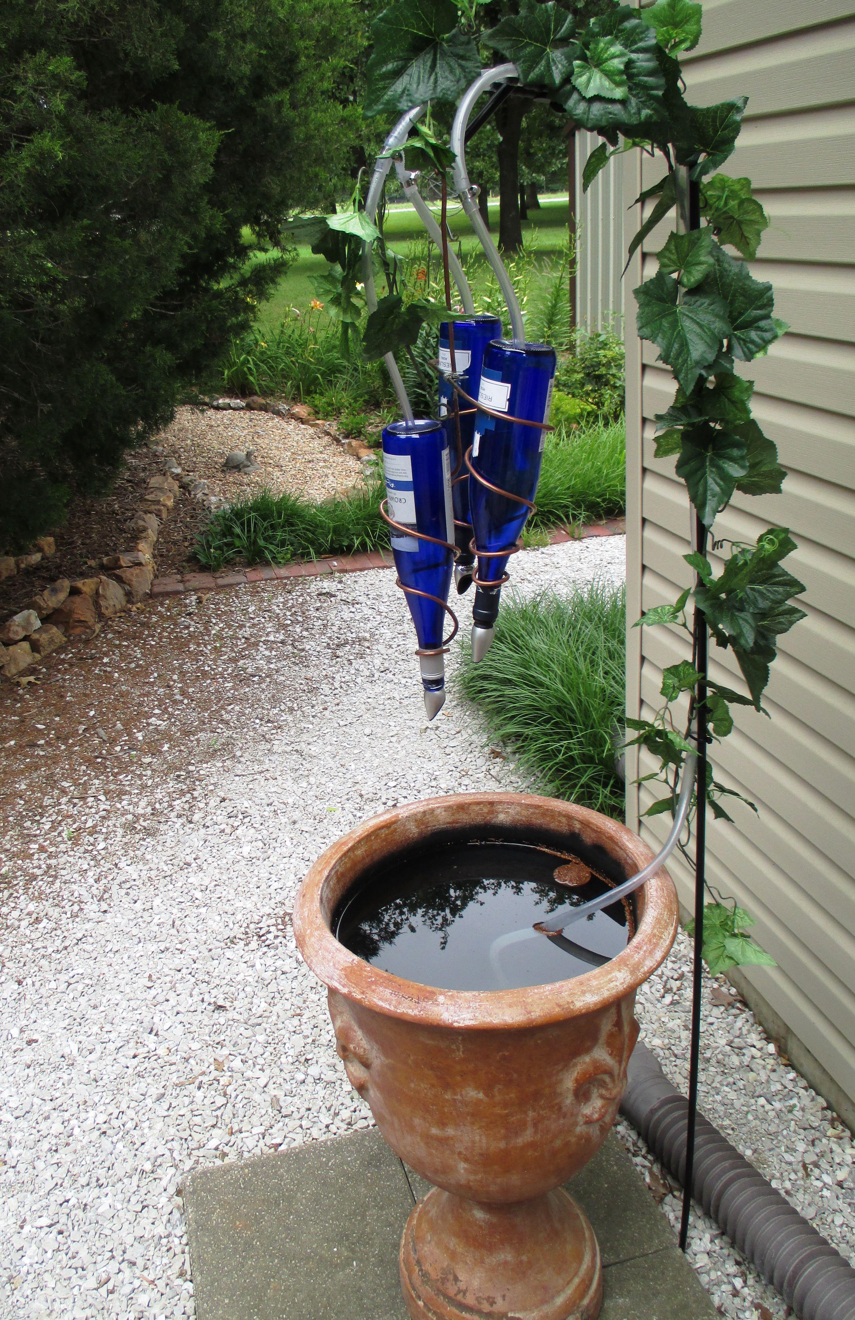 Https S Media Cache Ak0 Pinimg Com Originals 00 89 50 008950e065fedb3588754afc896e7187 Jpg Wine Bottle Fountain Diy Garden Fountains Fountains Outdoor