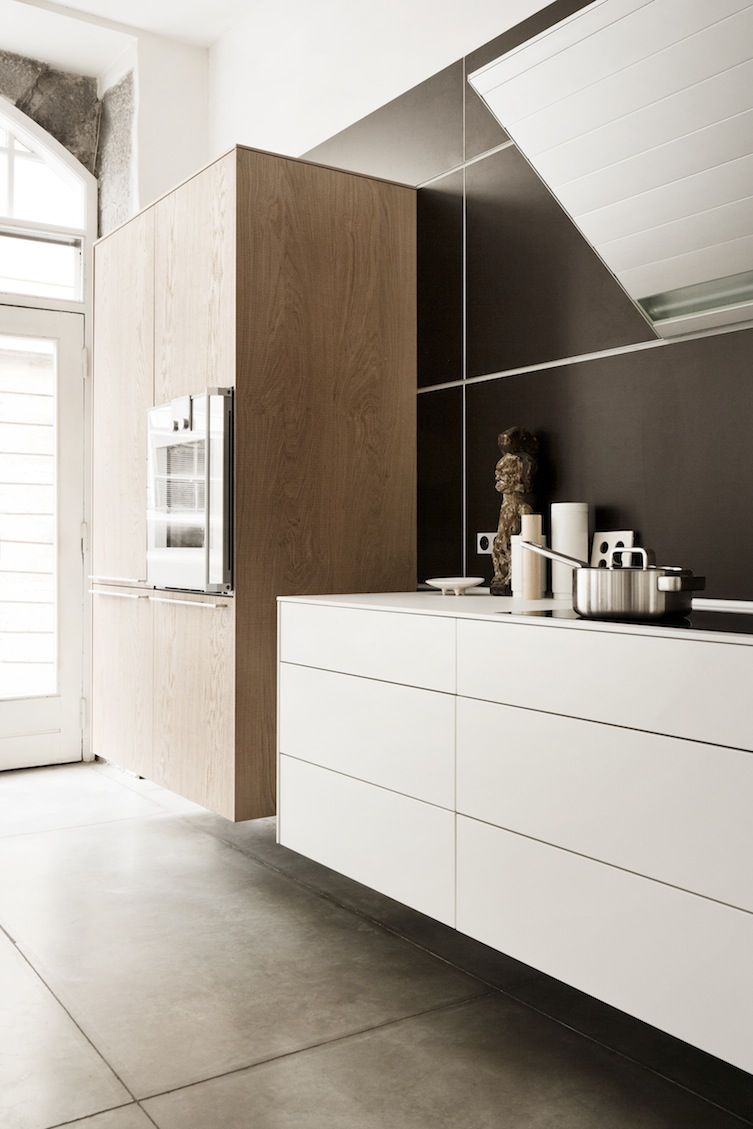 Long White Wooden Floating Mounted Shelves For Bottles Placed On The White Wall Of Won Wall Mounted Kitchen Shelves Kitchen Shelf Design Kitchen Shelving Units