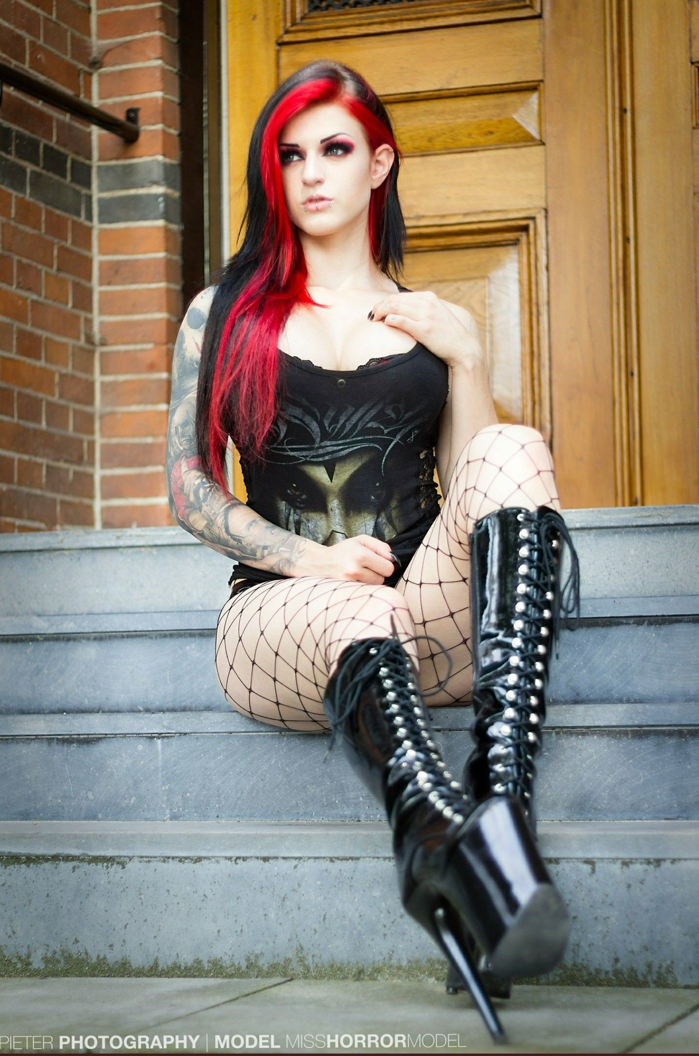 Cute redhead goth chick stripping on the couch