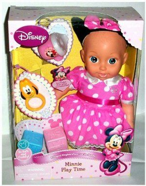 "Disney Minnie Play Time Baby Doll by TollyTots. $29.95. includes fun play accessories. soft and cuddly. approx. 15"" tall. Soft and cuddly, this Disney Minnie Play Time Doll stands approx. 15"" tall. Includes fun play accessories (play sippy cup, play Pluto rattle, & 2 play blocks.)"