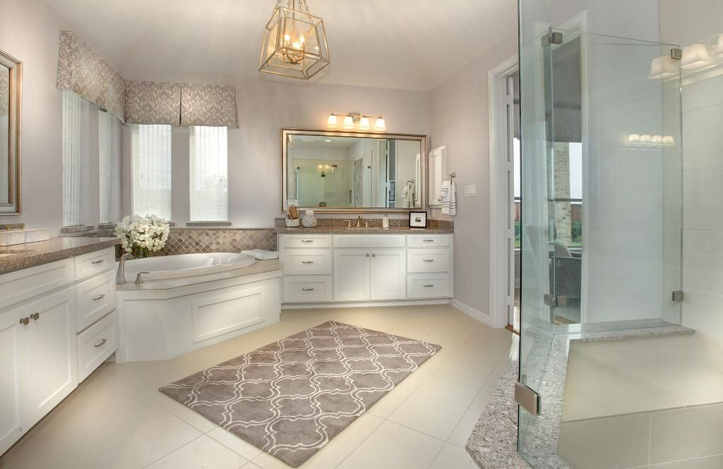 Master Bathroom With White Cabinets, A Glass Shower And A Corner Garden Tub;  The