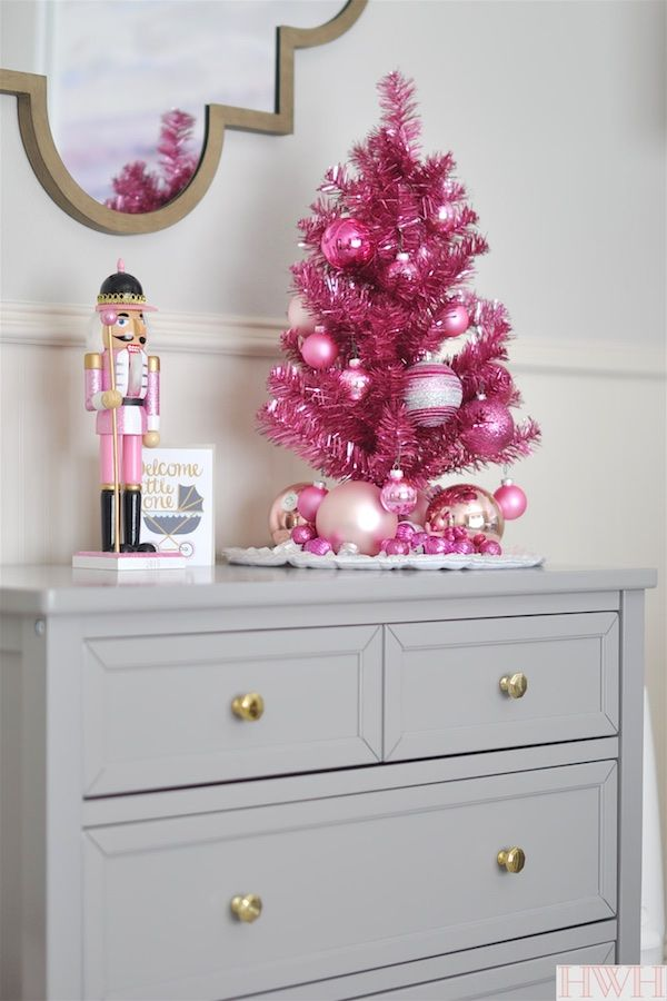 Festive Holiday Nursery With Pink Tinsel Christmas Tree Ornaments And Nuter