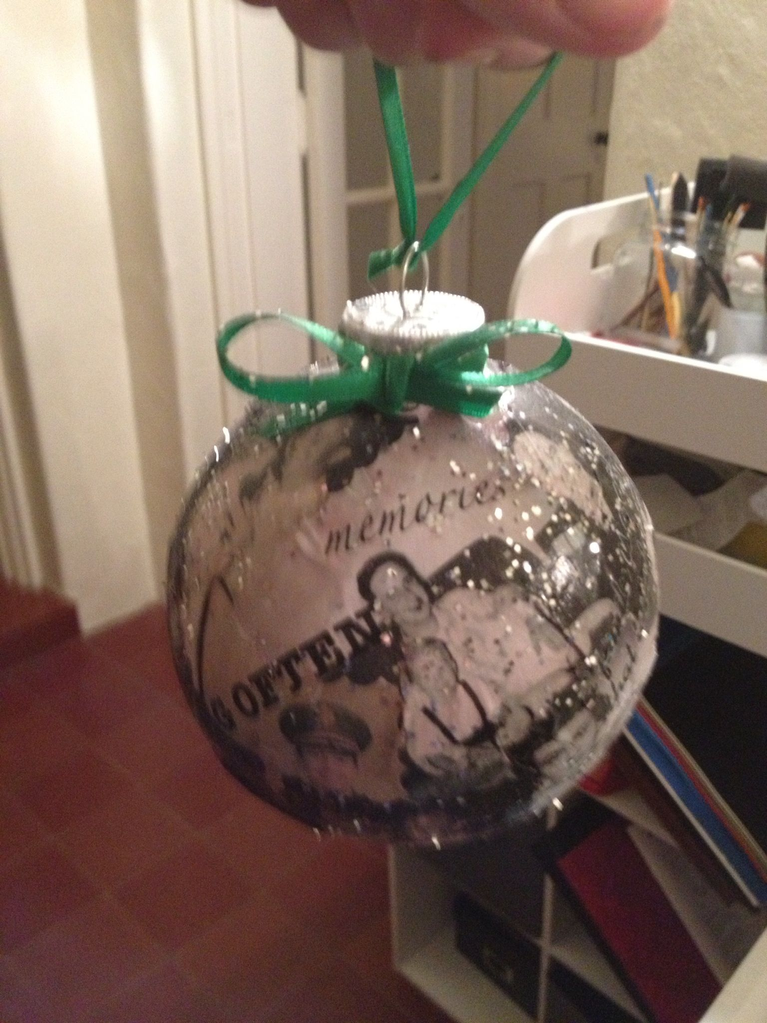 Easy gift idea! Just buy some clear glass or plastic ornaments at your local craft store. Tape some tissue paper to a sheet of printer paper, print your favorite photos, then use a thin layer of mod pudge to adhere to the ornament. Sprinkle with glitter and add a bow!