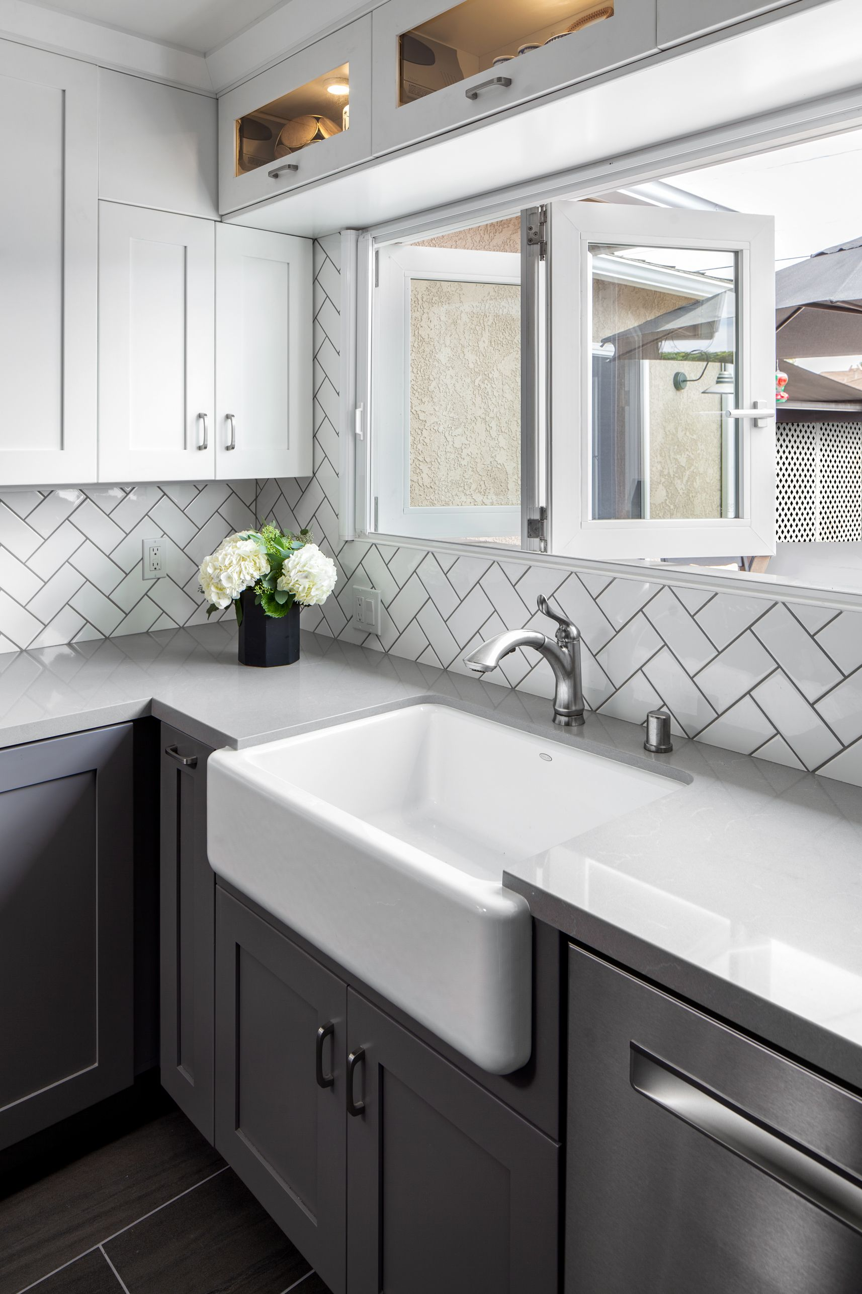 Remodeled Kitchen Complete With White Subway Tile Backsplash In Herringbone Pattern Gray And White Kitchen White Shaker Kitchen White Shaker Kitchen Cabinets