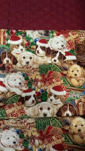 Chrismas - puppy material, dark red quilted backing & green satin binding