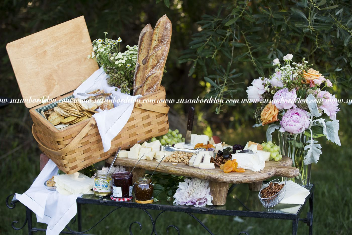 cheese and fruit display on vintage trunk backyard wedding be