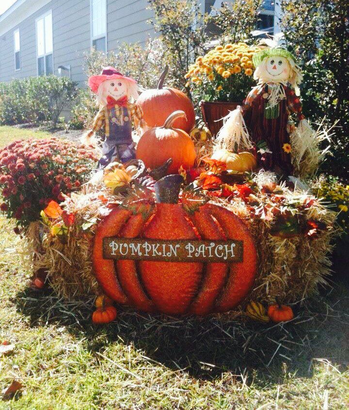 Fall Yard Display Pumpkins Mums Scarecrows Leaves And Hay