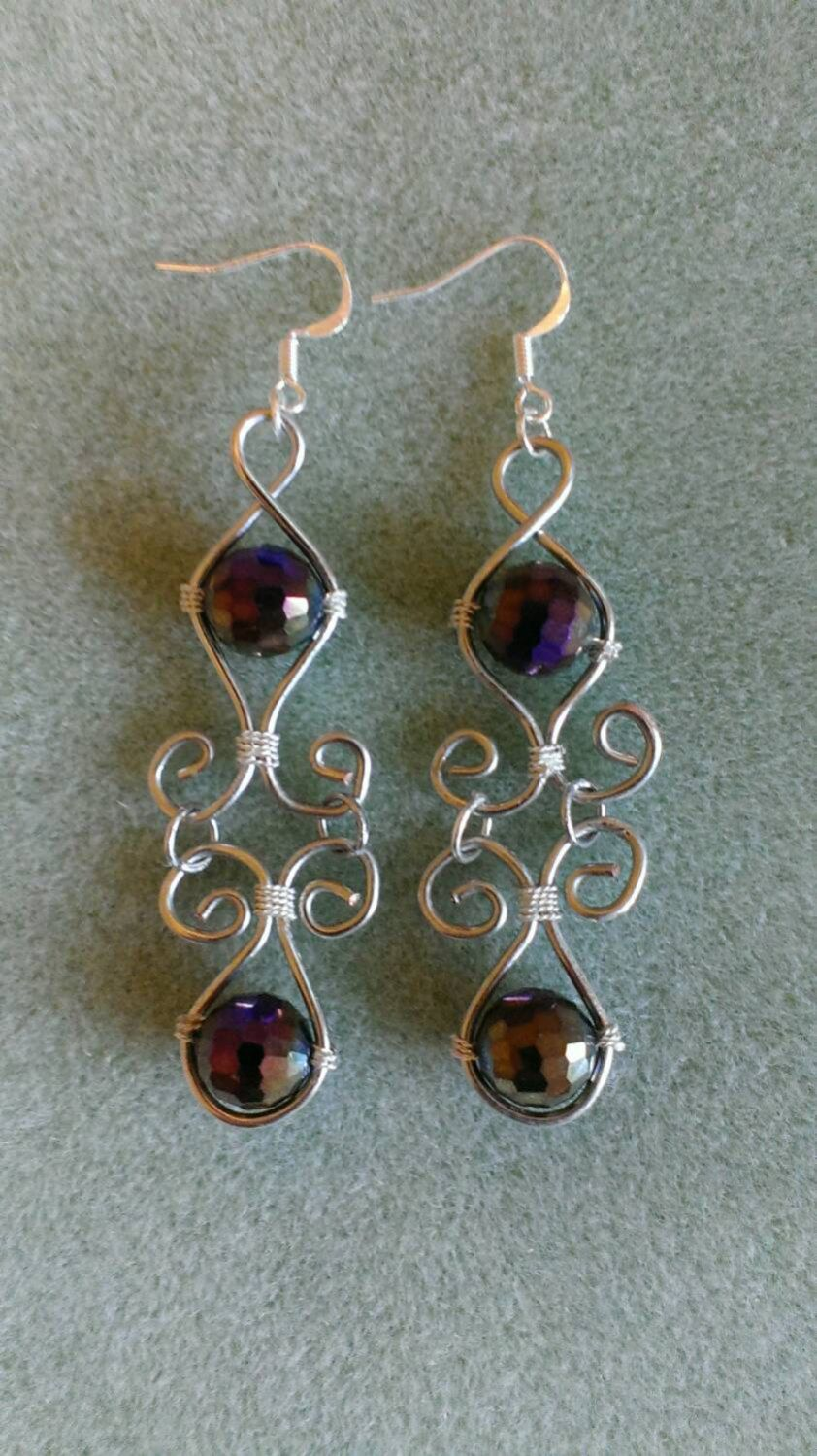 Silver wire dangles with lovely dark iridescent crystals by AnnyFancy on Etsy