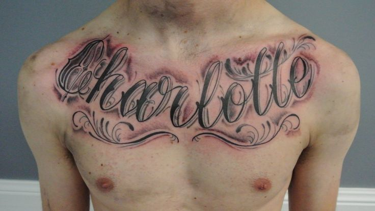 Charlotte Name Tattoo On Man Chest By Lou Shaw