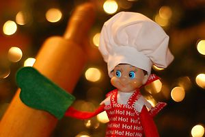 For the elf that likes to bake is a handmade baker's hat with an apron and even an oven mit. The crisp white cotton flouncy baker's hat fits over the hat that the elf comes with. The apron is cotton with HO HO HO printed in white over a bright red background. There are ties on the apron that tie around the neck and the waist and are sewn from the same fabric as the apron. Let's not forget the all important green felt oven mit that comes with the set.