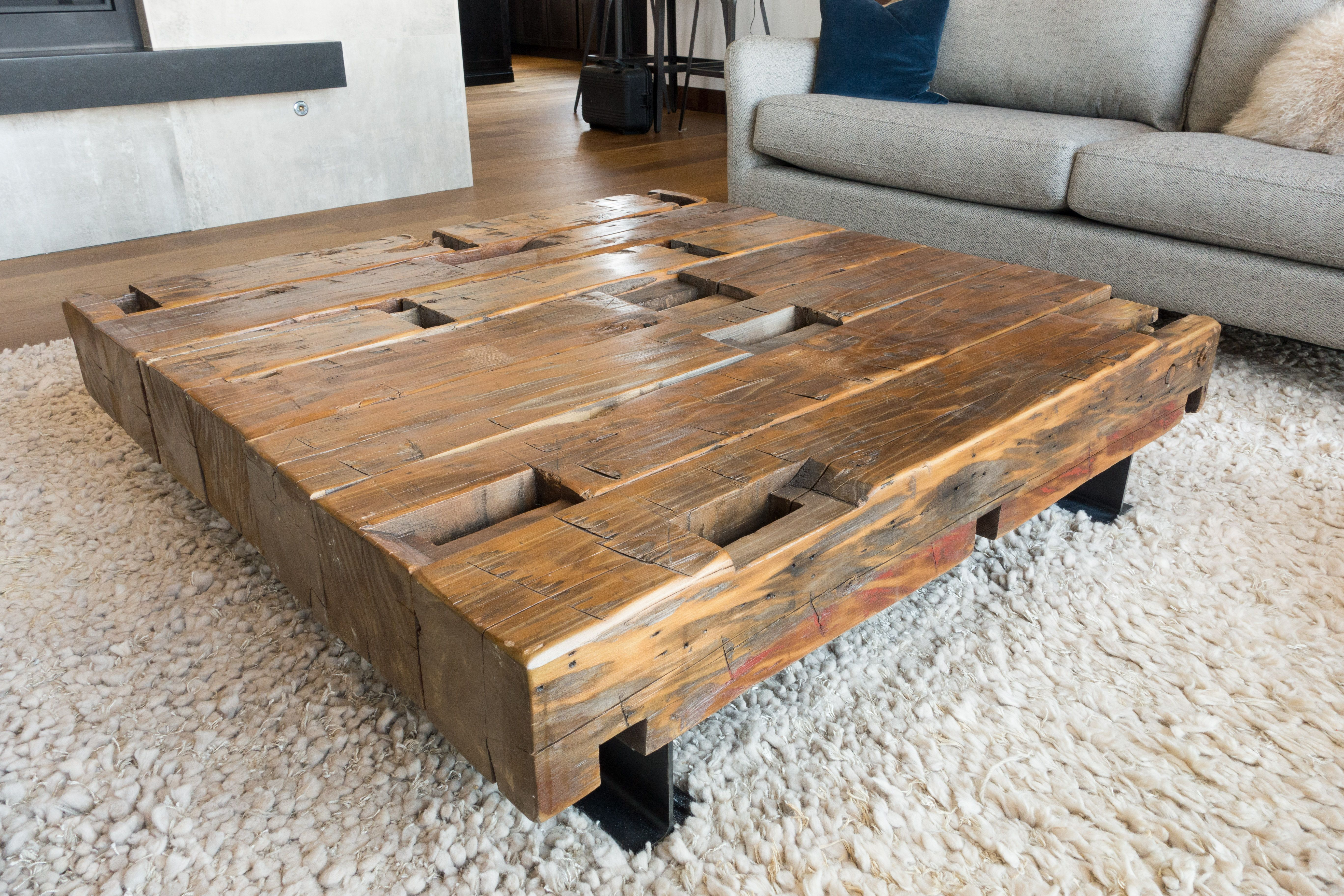 Coffee Table Made From Reclaimed Hand Hewn Beams Sitting On Old